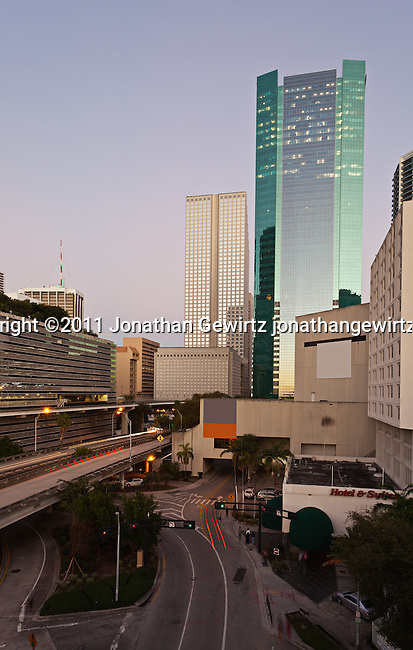 Twilight view of Miami's downtown commercial and hotel district, Knight Center, expressway ramps to US Route 95 and Metromover elevated rail tracks.