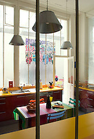 In a former Parisian warehouse in Barbès artist Hervé di Rosa has created a cosy and colourful kitchen/dining room
