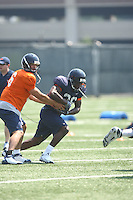 Virginia quarterback Marc Verica hands off to Virginia running back Max Milien during open spring practice for the Virginia Cavaliers football team August 7, 2009 at the University of Virginia in Charlottesville, VA. Photo/Andrew Shurtleff