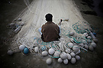 A fisherman on his fishing net on the northern shore of Bhola.?This area in the south of Bangladesh has been called ground zero of climate-change due to heavy river and ocean erosion. The lowlying area is also hugely affected by cyclones and rising sea-levels...By the Mouth of Ganges, at the Bay of Bengal is the Island of Bhola. This home of about two million people is considered to be ground zero of climate change. Half the island has disappeared in the past 40 years, and according to scientists the pace is not going to slow down. People pack up and leave as the water get closer. Some to a nearby embankment, while those with enough money move further inland, but for most life move on until the inevitable. It's always about survival for the people in one of the worlds poorest countries...Photo by: Eivind H. Natvig/MOMENT