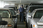 A Washington State Troopers conducting anti-terrorism patrols on Washington State Ferries to and from Seattle's Coleman Dock .  Jim Bryant Photo. ©2010. All Rights Reserved.