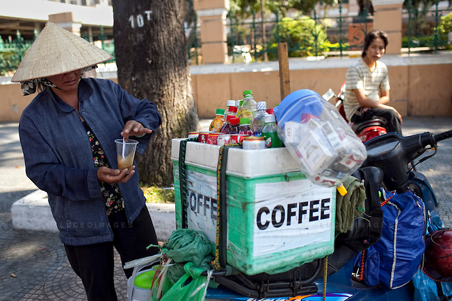 Phuong sells coffee to tourists near the post office in Ho Chi Minh City...Kevin German / LUCEO