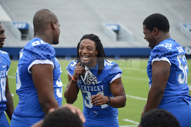 Kory Brown a sophomore linebacker shares a laugh with Langston Newton, a freshman defensive lineman at UK Football Media Day on Friday, August 3, 2012. Photo by Mike Weaver| Staff