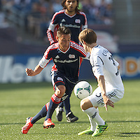 New England Revolution midfielder Diego Fagundez (14) on the attack.  In a Major League Soccer (MLS) match, the New England Revolution (blue) defeated LA Galaxy (white), 5-0, at Gillette Stadium on June 2, 2013.