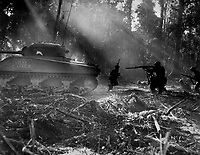 The Yanks mop up on Bougainville night at Japs would infiltrate American Lines.  At Dawn, the doughboys went out and killed them.  This photo shows tank going in its cover.  March 1944. (Army)<br /> Exact Date Shot Unknown<br /> NARA FILE #:  111-SC-189099<br /> WAR &amp; CONFLICT BOOK #:  1185
