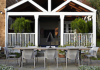 The porch has a traditional bread oven and is a comfortable place for relaxing that leads out onto the paved dining area for summer entertaining