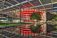 This is the Winespear Opera House in downtown Dallas at night.  We love the color of the glass in this wonderful red that reflects in the water feature at night.