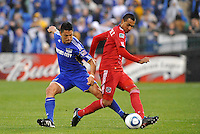 Julio Martinez , Roger Espinoza (blue)...Kansas City Wizards played to a 2-2 tie with Chicago Fire at Community America Ballpark, Kansas City, Kansas.
