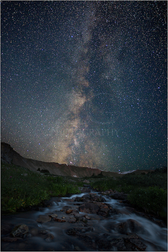 Early on the last day of July, I hiked up near the Continental Divide to capture the night sky. This Colorado picture shows the Milky Way a few hours before sunrise. I took a 35 second exposure of the Milky Way, then a long exposure of the foreground that was lit by a fading moon, giving the creek small stream and mountains a soft light with a little definition.