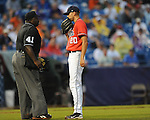 Ole Miss' Matt Crouse talks with umpire Randy Harvey vs. Auburn during the Southeastern Conference tournament at Regions Park in Hoover, Ala. on Friday, May 28, 2010.  (AP Photo/Oxford Eagle, Bruce Newman)