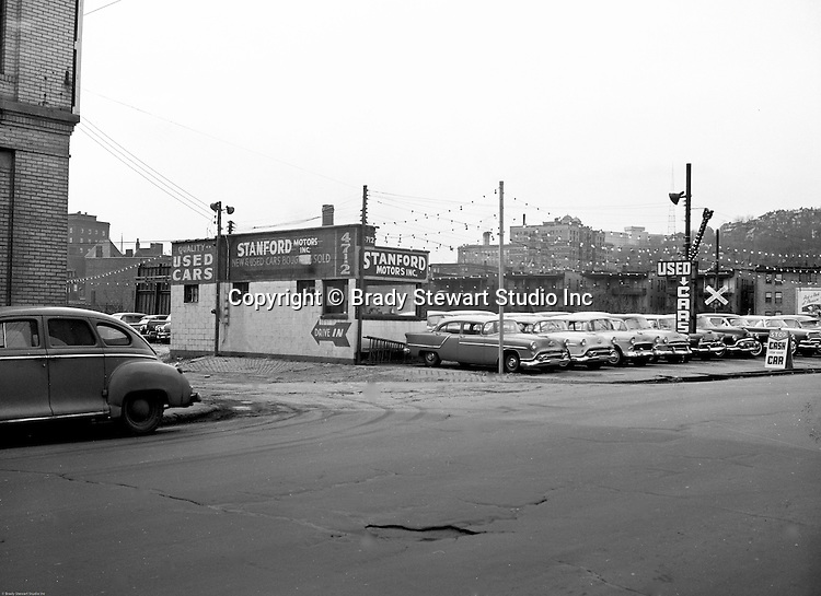 Pittsburgh PA:  View of Stanford Motors Used Car lot in the East Liberty section of Pittsburgh - 1956.