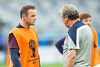 England manager Roy Hodgson talks to Wayne Rooney of England during training