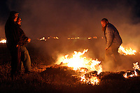 Sutton Scarsdale, England, 13/09/2004..Hunt supporters light bonfires in fields beside the M1 motorway to demonstrate against the proposed new bill to ban hunting with dogs.
