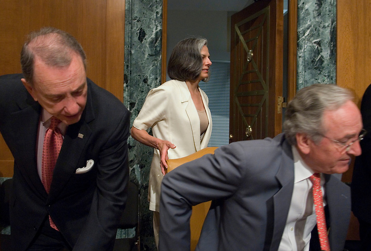 """Sen. Arlen Specter, R-Pa., and Sen. Tom Harkin, D-Iowa, take their seats as Julie Gerberding, director of the Centers for Disease Control and Prevention, arrives in the hearing room for the Senate Appropriations Committee Labor, Health and Human Services, and Education Subcommittee hearing on """"Cracks in the System - An Examination of One TB Patient's International Public Health Threat"""" on Wednesday, June 6, 2007.?"""