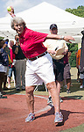 Waterbury, CT- 15 August 2015-081515CM15- Softball great, Joan Joyce, left,  throws out a pitch during a ceremony at Municipal Stadium in Waterbury on Saturday.  The softball diamond was named in Joyce's honor.     Christopher Massa Republican-American