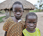 Two children in the Southern Sudan village of Ligitolo. Families here are rebuilding their lives after returning from refuge in Uganda in 2006 following the 2005 Comprehensive Peace Agreement between the north and south.