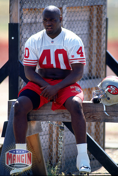 ROCKLIN, CA - William Floyd of the San Francisco 49ers takes a break during training camp at Sierra College in Rocklin, California in 1995. Photo by Brad Mangin