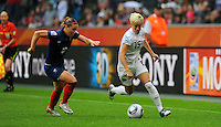 Megan Rapinoe (r) of team USA and Camille Abily of team France during the FIFA Women's World Cup at the FIFA Stadium in Moenchengladbach, Germany on July 13th, 2011.