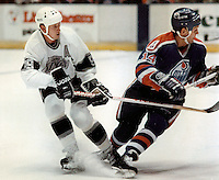 Wayne Gretzky of the Los Angeles Kings, the greatest hockey player of all time, tangles with an Edmoton Oilers player at the Great Western Forum in Los Angeles in 1988. Gretzky became the NHL's all-time leading scorer when he passed Gordie Howe's total of 1,850 points at Edmonton on October 15, 1989. (Photo by Alan Greth)