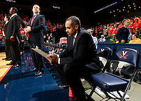 CHARLOTTESVILLE, VA- DECEMBER 6: Head coach Paul Hewitt of the George Mason Patriots writes out a game play during the game on December 6, 2011 against the Virginia Cavaliers at the John Paul Jones Arena in Charlottesville, Virginia. Virginia defeated George Mason 68-48. (Photo by Andrew Shurtleff/Getty Images) *** Local Caption *** Paul Hewitt