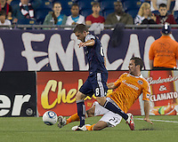 Houston Dynamo defender Hunter Freeman (21) clears ball away from New England Revolution midfielder Chris Tierney (8). In a Major League Soccer (MLS) match, the New England Revolution tied Houston Dynamo, 1-1, at Gillette Stadium on August 17, 2011.