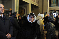 A parishioner during Christmas mass at the Christmas Church in Odessa, Ukraine on January 7, 2016.  Orthodox Christians around the world celebrate Christmas on January 7.