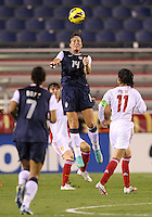 BOCA RATON, FL - DECEMBER 15, 2012: Abby Wambach (14) of the USA WNT heads over Pu Wei (11)  China WNT during an international friendly match at FAU Stadium, in Boca Raton, Florida, on Saturday, December 15, 2012. USA won 4-1.