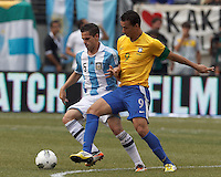 Argentina midfielder Fernando Gago (5) dribbles as Brazil forward Leandro Damiao (9) pressures. In an international friendly (Clash of Titans), Argentina defeated Brazil, 4-3, at MetLife Stadium on June 9, 2012.