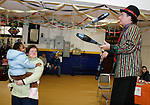 TORRINGTON, CT 01/01/09- 010209BZ04- Lois Knight and her daughter Meeka, 3, of Torrington,  watch stilt walker and juggler Robert Carroll perform during &quot;last night&quot;activities at the Torrington Armory Friday night.   The event, a celebration usually held on New Year's Eve, was rescheduled due to inclement weather.<br /> Jamison C. Bazinet Republican-American