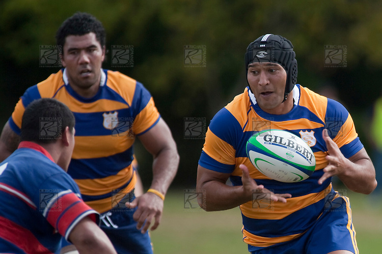 Stephen Wofgram takes the ball & lines up Gary Saifoloi at the same time. Counties Manukau Premier Counties Power Cup club rugby game between Patumahoe & Ardmore Marist played at Patumahoe Domain on Saturday March 28th, 2009..Patumahoe won 54 - 15 after leading 28 - 3 at halftime.