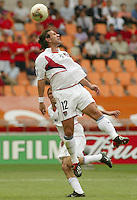 Jeff Agoos leaps for a header. The USA tied South Korea, 1-1, during the FIFA World Cup 2002 in Daegu, Korea.