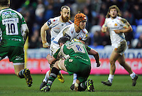 Ollie Atkins of Exeter Chiefs takes on the London Irish defence. Aviva Premiership match, between London Irish and Exeter Chiefs on February 21, 2016 at the Madejski Stadium in Reading, England. Photo by: Patrick Khachfe / JMP