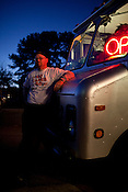 Mike Stenke, the proud proprietor of the Raleigh-based food truck, Klausie's Pizza, parked outside Big Boss brewery Friday, Nov. 12, 2010. Stenke is lobbying the City of Raleigh on behalf of food truck owners for greater access to park and serve throughout downtown Raleigh.