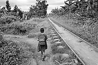 A young orphan girl walks along the railroad tracks on her way to school in Kampala, Uganda on April 20, 2001. More than 13 million African children have been orphaned by the the AIDS pandemic. Worldwide, more than 20 million people have died since the first cases of AIDS were identified in 1981.