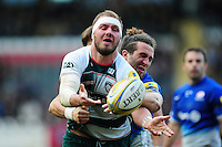 Lachlan McCaffrey of Leicester Tigers offloads the ball after being tackled. Aviva Premiership match, between Leicester Tigers and Saracens on March 20, 2016 at Welford Road in Leicester, England. Photo by: Patrick Khachfe / JMP