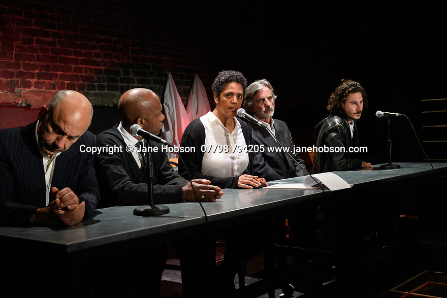 """London, UK. 10.04.2017. A brand new adaptation of Albert Camus' """"The Plague"""" opens at the Arcola Theatre. Adapted and directed by Neil Bartlett. Picture shows: Joe Alessi (Mr Cottard), Burt Caesar (Grand), Sara Powell (Dr Rieux), Martin Turner (Mr Tarrou), Billy Postlethwaite (Mr Rambert). Photograph © Jane Hobson."""