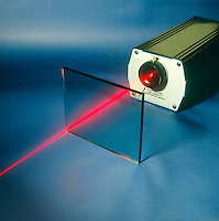TRANSMISSION of GAS LASER BEAM (1 of 2)<br /> Through Glass Plate At 90' Angle<br /> The beam of a Helium neon laser passing through glass at 90' angle is not reflected.