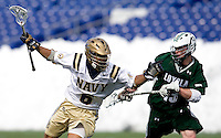 Nikk Davis (6) of Navy tries to get past Michael Crimmins (13) of Loyola at the Navy-Marine Corp Memorial Stadium in Annapolis, Maryland.   Loyola defeated Navy, 8-7, in overtime.