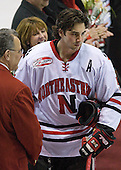 Louis Liotti (Northeastern - 5) and parents - The Northeastern University Huskies defeated the Boston College Eagles 2-1 OT in the NU senior night game on Friday, March 6, 2009 at Matthews Arena in Boston, Massachusetts.