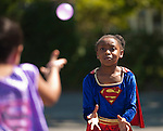 WATERBURY, CT--- -081415JS11- London Lacey, keeps her eye on the water balloon during the balloon toss during Super Hero Day at Camp Summer Sunshine Friday at Chase School in Waterbury.  <br /> Jim Shannon Republican-American