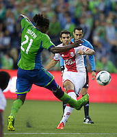 Diego Valeri, right, of the Portland Timbers takes a shot as Shalrie Joseph of the Seattle Sounders FC defends during play at CenturyLink Field in Seattle Saturday August, 3, 2013. The Sounder won the match 1-0.