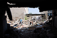 Civilian buildings in the Georgian city of Gori, destroyed by the attacks from the Russian army in the first weeks of August..The population is now searching for the bodies of their killed relatives and slowly recovering and rebuilding what remain from their houses. A dangerous task due to the heavy damage to the structure of the buildings and to the remain on explosive objects from the cluster bombs used by the Russian Air Force.