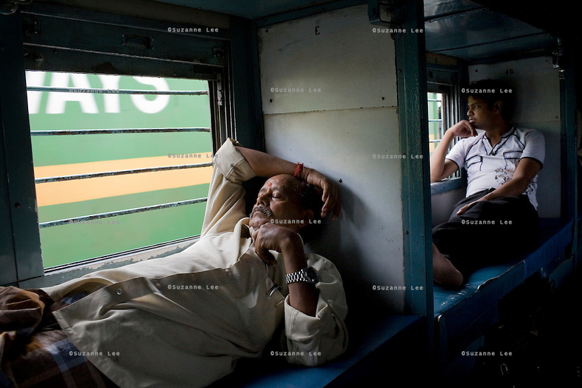Train passengers on the Himsagar Express 6318 as it passes through Maharashtra on 8th July 2009.. .6318 / Himsagar Express, India's longest single train journey, spanning 3720 kms, going from the mountains (Hima) to the seas (Sagar), from Jammu and Kashmir state of the Indian Himalayas to Kanyakumari, which is the southern most tip of India...Photo by Suzanne Lee / for The National