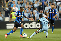 KANSAS CITY, KS - June 1, 2013:<br /> Colleen Warner (18) midfield Montreal Impact in action.<br /> Montreal Impact defeated Sporting Kansas City 2-1 at Sporting Park.
