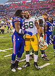 14 December 2014: Green Bay Packers inside linebacker Sam Barrington (58) has a post-game smile with Buffalo Bills running back Anthony Dixon (26) at Ralph Wilson Stadium in Orchard Park, NY. The Bills defeated the Packers 21-13, snapping the Packers' 5-game winning streak and keeping the Bills' 2014 playoff hopes alive. Mandatory Credit: Ed Wolfstein Photo *** RAW (NEF) Image File Available ***