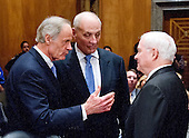 General John F. Kelly, USMC (Retired), center, speaks with United States Senator Tom Carper (Democrat of Delaware), left, and former US Secretary of Defense Robert Gates, right, as he arrives to testify before the United States Senate Committee on Homeland Security and Governmental Affairs confirmation hearing on his nomination to be Secretary, US Department of Homeland Security on Capitol Hill in Washington, DC on Tuesday, January 10, 2017.<br /> Credit: Ron Sachs / CNP