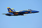 Blue Angel #5, the lead solo, enters the airshow box enroute to a head on pass with Blue Angel #6 as part of the Blue Angels flight demonstration over San Francisco Bay. The Blue Angels were the featured aerial performers of the 2008 San Francisco Fleet Week event. The Blue Angels fly the Boeing built F/A-18 Hornet.