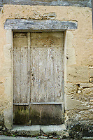 Traditional old wooden French doorway in quaint town of Castelmoron d'Albret in Bordeaux region, Gironde, France
