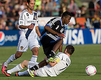 Marvin Chavez of Earthquakes tries to control the ball away from Robbie Keane of Galaxy during the game at Buck Shaw Stadium in Santa Clara, California on October 21st, 2012.  San Jose Earthquakes and Los Angeles Galaxy tied at 2-2.
