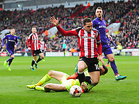 Sheffield United's Billy Sharp goes down in the penalty area after a challenge from Charlton Athletic's Declan Rudd but his appeals for the penalty were turned down<br /> <br /> Photographer Chris Vaughan/CameraSport<br /> <br /> The EFL Sky Bet League One - Sheffield United v Charlton Athletic - Saturday 18th March 2017 - Bramall Lane - Sheffield<br /> <br /> World Copyright &copy; 2017 CameraSport. All rights reserved. 43 Linden Ave. Countesthorpe. Leicester. England. LE8 5PG - Tel: +44 (0) 116 277 4147 - admin@camerasport.com - www.camerasport.com